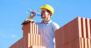 Builder Drinking Water To Avoid Heat Stress