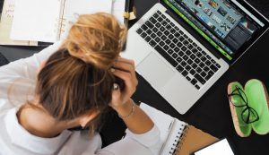 Woman Looking Stressed In Front Of Laptop Tech Overload